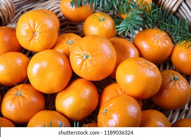 Fresh ripe clementines on wood background