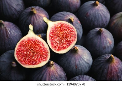 Fresh ripe figs as background, top view. Tropical fruit