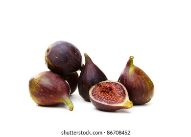 Fresh ripe figs and a juicy slice on white background