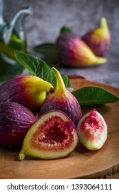 Fresh ripe figs on dark table. Healthy mediterranean fig fruit. Fresh figs on black background. Beautiful blue violet figs with empty copyspace close up