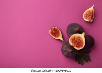 Fresh ripe figs on pinkbackground. Top view.
