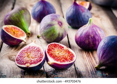 Fresh ripe figs on a wooden background