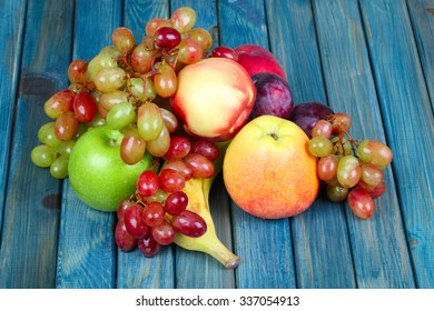 fresh ripe fruits lying on the rustic wooden table