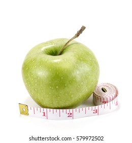 Fresh ripe green apple with a measure tape on a white background
