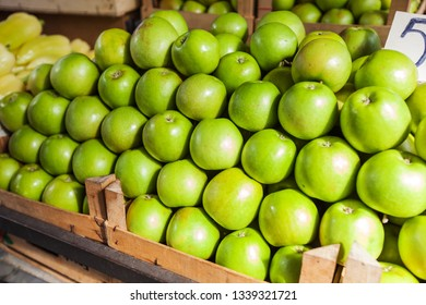 fresh ripe green apples Granny Smith ready for sale at farmers market stall