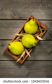 Fresh Ripe Green Pears on a Wooden Table. Selective focus.
