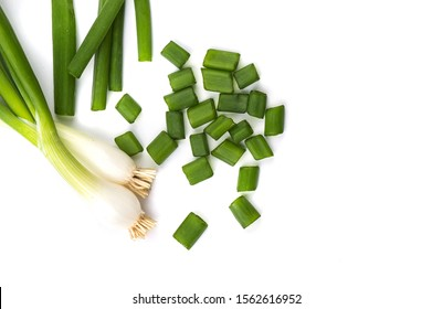 Fresh ripe green spring onions (shallots or scallions) with fresh chopped green onions on white background