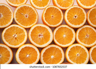 Fresh ripe half cut oranges .