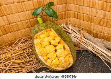 Fresh ripe jackfruit. Fresh sweet jackfruit segment ready for eat. Cutting jackfruit. Vegetarian, vegan, raw food.Tropical fruit. Selective focus.
