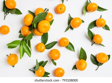 Fresh ripe mandarines on the rustic wooden background. Selective focus. Shallow depth of field.