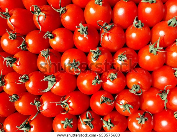 Fresh ripe medium-sized tomatoes lined in a row, may be used as background