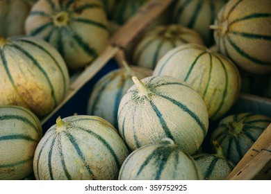 Fresh ripe melons forming background on farmers market