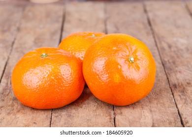 fresh, ripe orange mandarins on wooden background