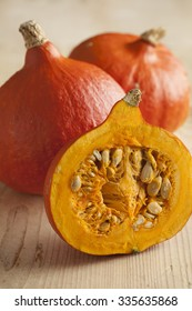 Fresh ripe orange whole and half hokkaido pumpkin
