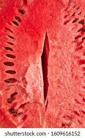 Fresh ripe organic watermelon cut with seeds as an erotic vagina symbol background.