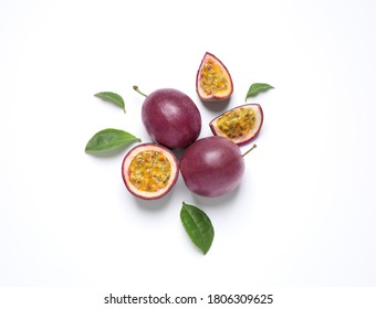 Fresh ripe passion fruits (maracuyas) with leaves on white background, flat lay - Shutterstock ID 1806309625