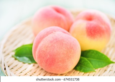 Fresh Ripe Peaches on a Japanese Zaru