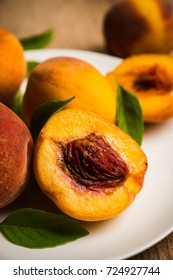 Fresh ripe peaches on the rustic background. Selective focus.