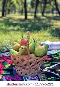fresh ripe pears in a basket