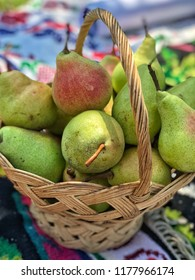 fresh ripe pears in a basket for picnic