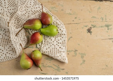 fresh and ripe pears on a wooden table