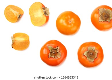 fresh ripe persimmons with slices isolated on white background. top view