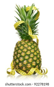 Fresh ripe pineapple with a measure tape isolated on white background
