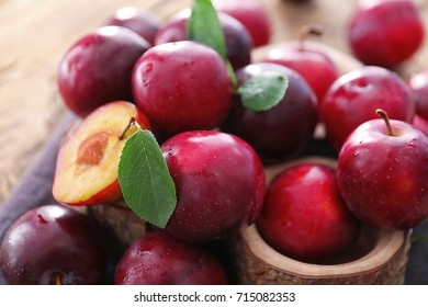 Fresh ripe plums on table, closeup