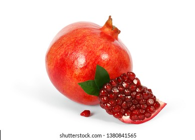 Fresh ripe pomegranate with green leaves isolated on white background. Clipping Path.