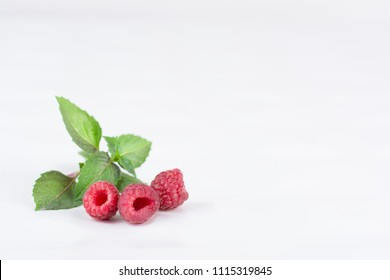 Fresh ripe raspberries on a white background. Close-up, minimal concept of fashion food