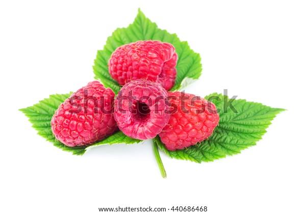 Fresh, ripe raspberries over green leaves, isolated on white background