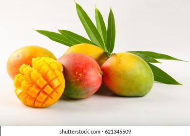 Fresh ripe raw mangoes over white background.