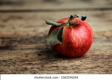 Fresh ripe red Apple with leaves