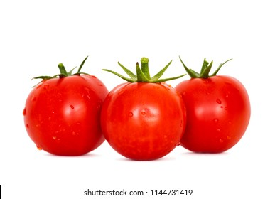 Fresh ripe red tomatoes on the white background. Harvested tomatoes on white background