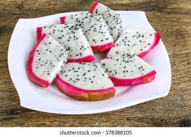 Fresh ripe Sliced dragon fruit on the white plate