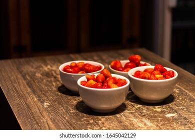 Fresh ripe strawberries in a white bowl