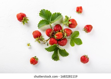 Fresh ripe strawberry berries on white background. Top view. Copy space. Flat lay.