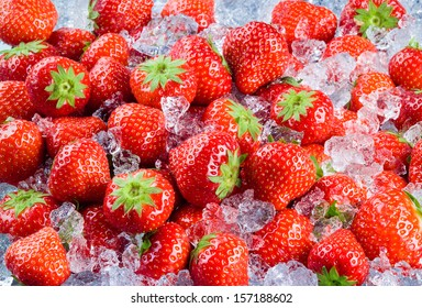 Fresh ripe strawberry with ice. Fruit Background