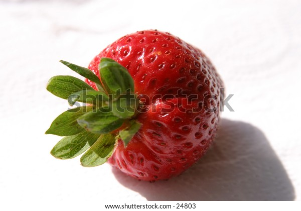 fresh ripe strawberry on white background and nice shadows