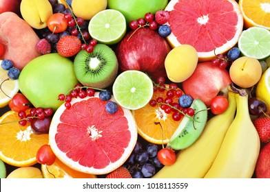 Fresh ripe sweet assorted fruits: apple, orange, grapefruit, qiwi, banana, lime, blueberry, strawberry, raspberry, peach, cherry, blueberry, currant, grape; colorful fruit background