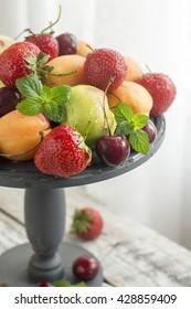 Fresh Ripe Sweet Fruits on the Wooden stand . Fresh Organic Food. Fresh Berries