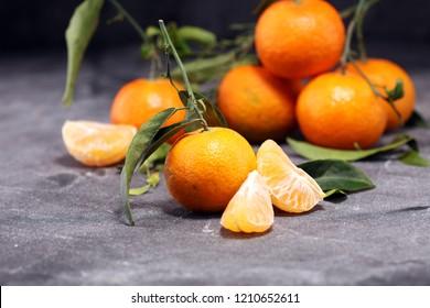 fresh ripe tangarines, food closeup on grey background.