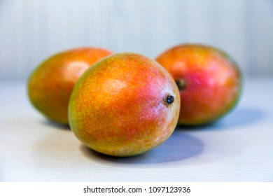 Fresh ripe tasty mangoes on a show-window of shop