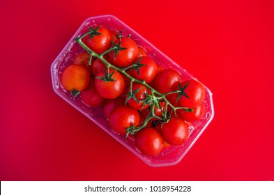 Fresh ripe tomatoes on a colorful background