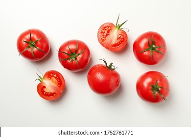 Fresh ripe tomatoes on white background, top view