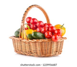 Fresh ripe vegetables in a basket isolated on white background