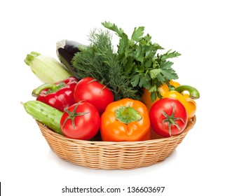 Fresh ripe vegetables in basket. Isolated on white background