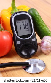 Fresh ripe vegetables, glucose meter and medical stethoscope lying on wooden table, diabetes, healthy lifestyle and nutrition,  result of measurement of sugar