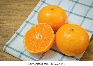 Fresh Ripe Whole and Cross Section Oranges on A Wooden Table, Orange Is The Fruit of The Citrus Species.