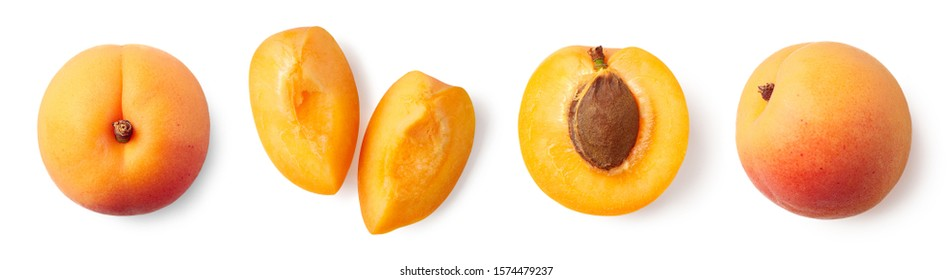 Fresh ripe whole, half and sliced apricot isolated on white background, top view